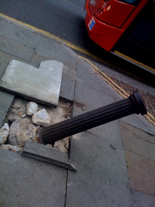 Bus stop's busted bollard next to big budget bazaar