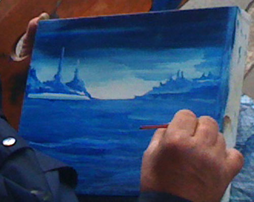 Kevin painting a landscape in oils, closeup