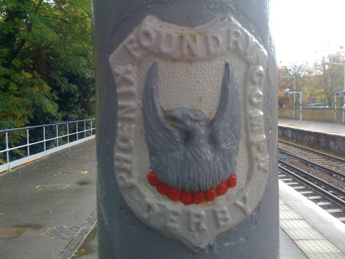 Logo showing The Phoenix Foundry Company, Derby, at Blackheath Station